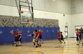 Kids playing basketball match second graders were having a on saturday at gateway high school near seattle usa Royalty Free Stock Image