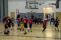 Kids playing basketball match second graders were having a on saturday at gateway high school near seattle usa Stock Photo