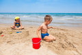 Kids playing on the beach and building sandcastle Royalty Free Stock Photos