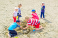 Kids playing at the beach group of is Royalty Free Stock Photo