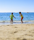 Kids playing at beach sea shore under sunlight Royalty Free Stock Photography