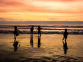 Kids playing on beach at sunset in summer Stock Photos
