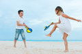 Kids playing beach tennis little on summer vacation Stock Images