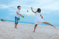 Kids playing beach tennis Royalty Free Stock Photo