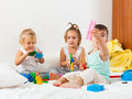 Kids playing on   bed Royalty Free Stock Photo