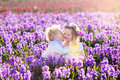 Kids playing in blooming garden with hyacinth flowers Royalty Free Stock Photo