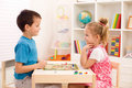 Kids playing board game in their room Royalty Free Stock Photo