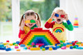 Kids playing with colorful blocks Royalty Free Stock Photo