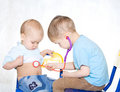 Kids playing doctor Royalty Free Stock Photo