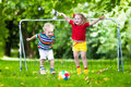 Kids playing football in school yard Royalty Free Stock Photo