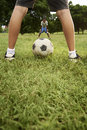 Kids playing football and soccer game in park Royalty Free Stock Photo