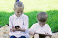 Kids playing games on a tablet PC and smartphone