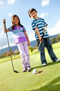 Kids playing golf Royalty Free Stock Images