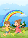 Kids playing at the hilltop with a rainbow in the sky illustration of Stock Image
