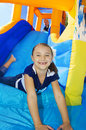 Kids playing on an inflatable slide bounce house Royalty Free Stock Photo