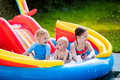 Kids playing in inflatable swimming pool
