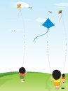 Kids playing kites open ground Royalty Free Stock Images