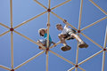 Kids playing on monkey bars view toward blue sky Royalty Free Stock Photo