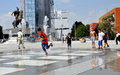 Kids Playing in the Mother Teresa Square fountain Royalty Free Stock Photo