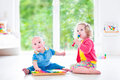 Kids playing music with xylophone Royalty Free Stock Photo