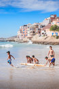 Kids playing with old surfboard,Taghazout surf village,agadir,morocco 2 Royalty Free Stock Photo