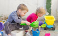 Kids playing in playground with sand and toys Stock Images