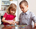 Kids playing puzzles children at home Royalty Free Stock Images