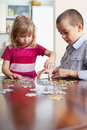 Kids playing puzzles children at home Stock Image