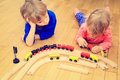 Kids playing with railroad learning and daycare trains indoor Stock Photography