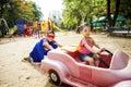 Kids Playing Riding Cart Outdo...