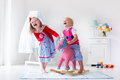 Kids playing with rocking horse Royalty Free Stock Photo
