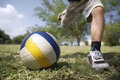 Kids playing soccer game young boy hitting ball in park football child Stock Photos