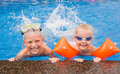 Kids playing in the swimming pool Royalty Free Stock Photo