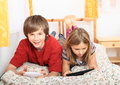 Kids playing with tablet and smartphone