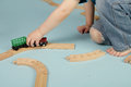 Kids playing with toy trains playtime games sharing Royalty Free Stock Photos