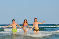 Kids playing in water against the waves Royalty Free Stock Image