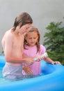 Kids in pool measuring temperature