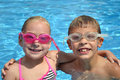 Kids in pool two a swimming smiling Stock Photos