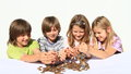 Kids pooring money thru hands Royalty Free Stock Photo
