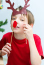 Kids portrait cute happy little boy playing with christmas masks Stock Images