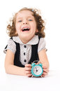Kids portrait little pretty happy girl with clock isolated over white Stock Photo