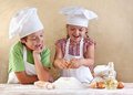 Kids preparing the dough for a cookie Royalty Free Stock Images