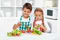 Kids preparing vegetables on a stick for a healthy snack Royalty Free Stock Photo