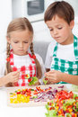 Kids preparing veggies on stick Royalty Free Stock Photo
