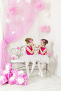 Kids with presents birthday party happy. Girl sisters playing Royalty Free Stock Photo