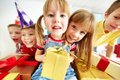 Kids with presents joyful girls gifts looking at camera happy lads on background Stock Photography