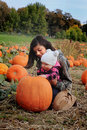 Kids in pumpkin patch Royalty Free Stock Photo