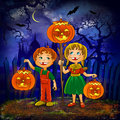 Kids with pumpkins celebrate halloween. Royalty Free Stock Image