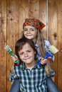Kids ready to repaint wooden wall Royalty Free Stock Photo