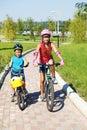 Kids riding bikes in park Royalty Free Stock Photo